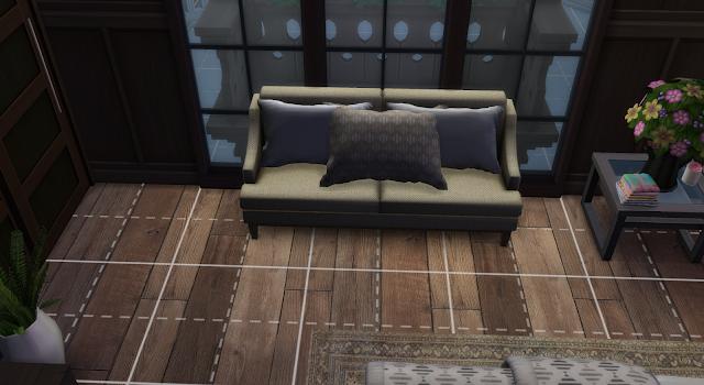 sofá de una habitación de una casa en los sims 4
