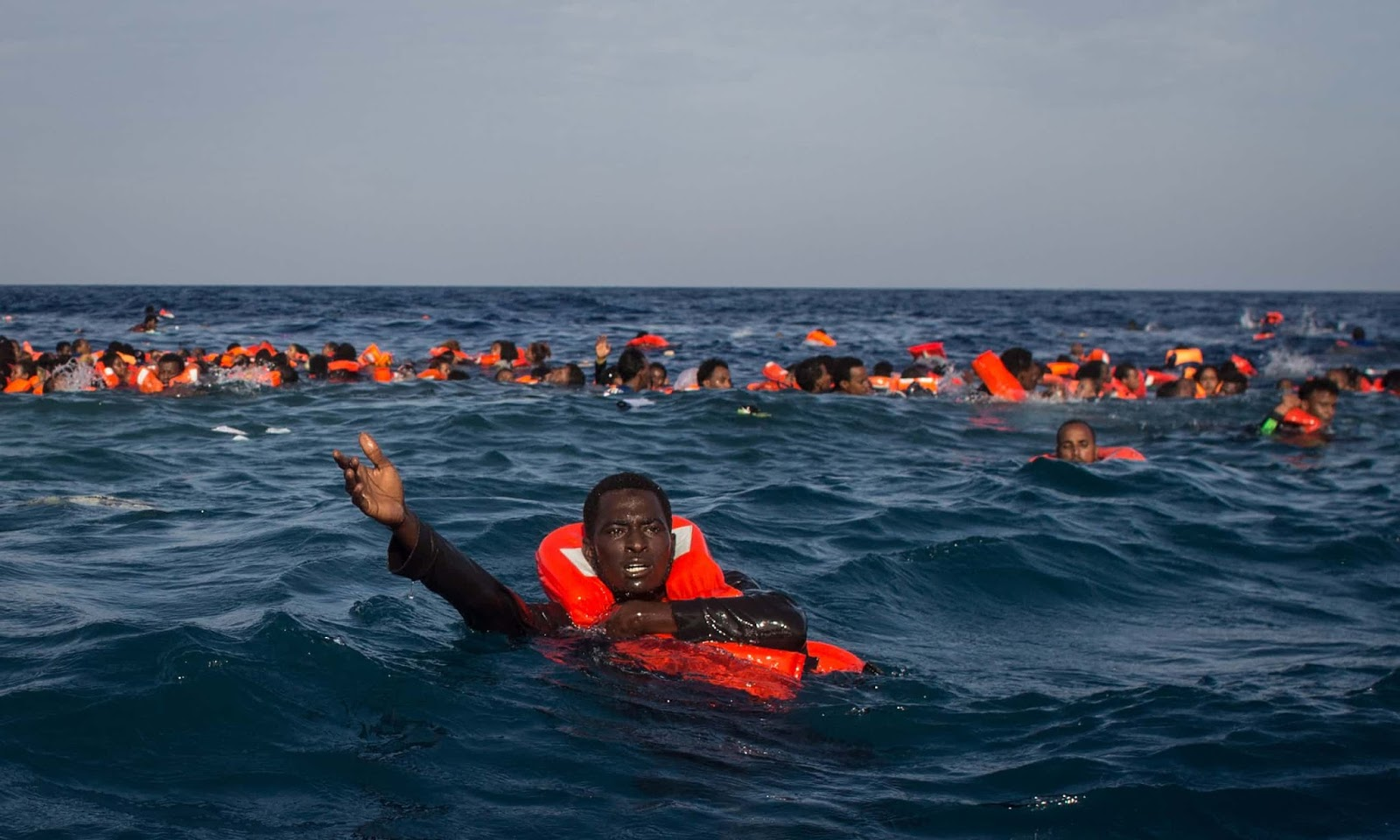 25 Of The Most Intriguing Pictures Of 2017 - Refugees from a capsized boat off Lampedusa, Italy