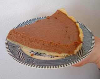 a side view of a piece of my healthier chocolate-orange lite cheesecake.jpeg
