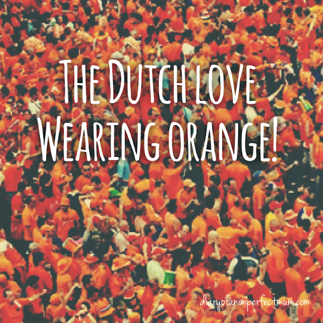 Text: The Dutch love wearing Orange - a huge crowd all wearing orange