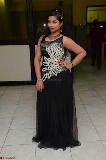 Shrisha Dasari in Sleeveless Short Black Dress At Follow Follow U Audio Launch 030.JPG