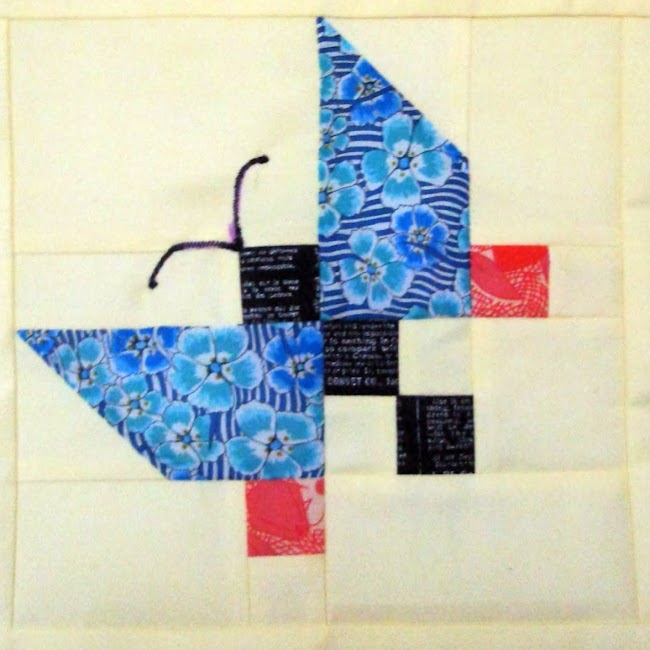 patchwork butterfly made up of pieced squares and rectangles