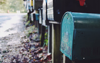 Mailboxes lined up along a dirt road