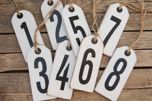 Plywood scraps turned distressed number tags