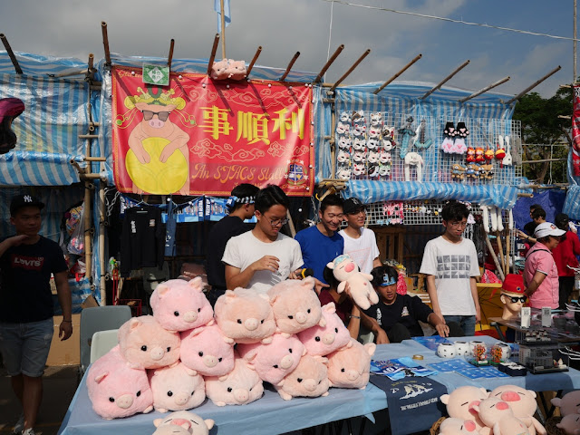 Fa Hui Lunar New Year Fair stall selling stuffed toy pigs