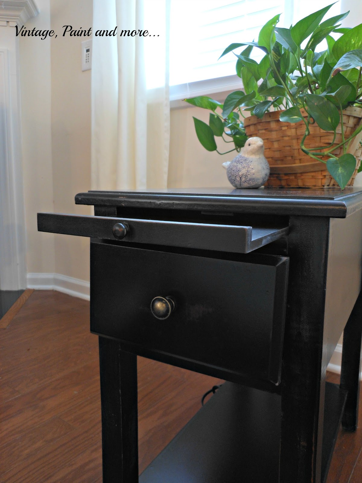 an added tabletop extension for a small side table