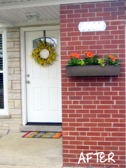 The brick wall in the front of our house definitely got an upgrade with this upcycled planter box.