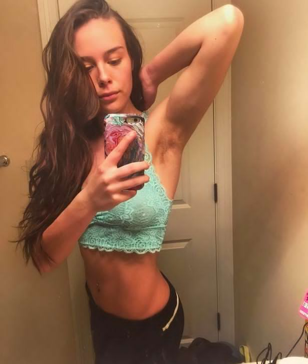 Fitness blogger who hasn't shaved any of her body hair for more than a year shows off her natural look