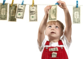 A child hanging money.