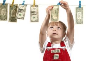 A child hanging money.