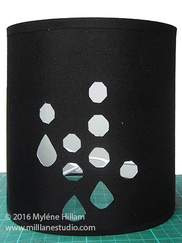 Lamp shade with all the holes cut out for each of the crystals.
