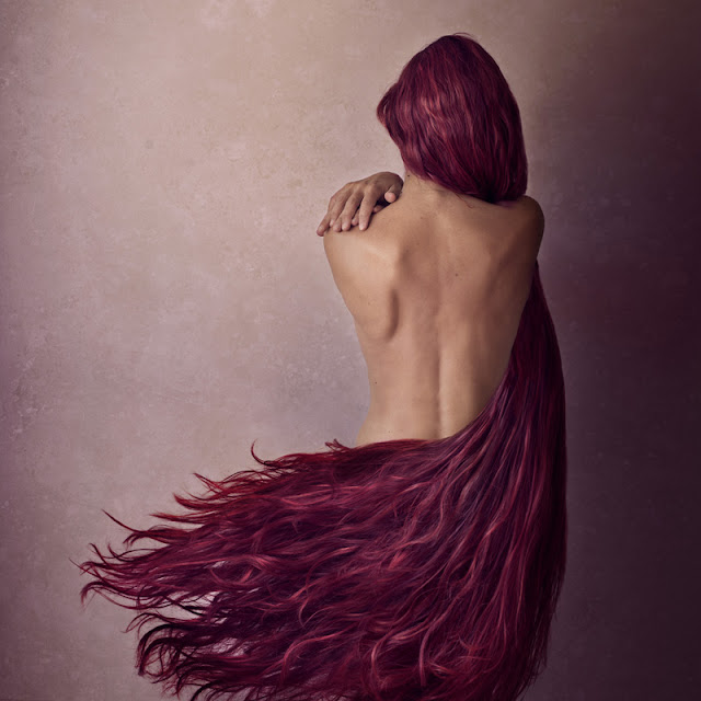 "First artwork sold this year! ""The embrace"", a 50x50cm limited edition print of 15, featuring a woman's back embraced by red/pinkish long hair."
