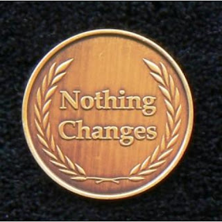 A coin depicting that nothing changes within the UK Care System and the CQC