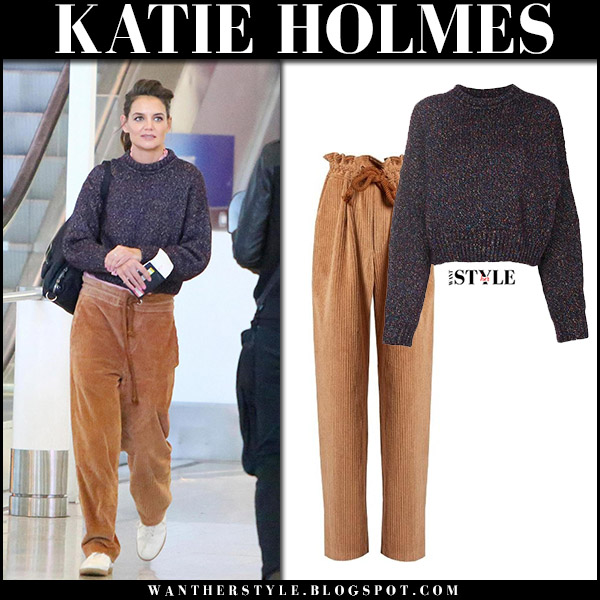 Katie Holmes in purple knit sweater and brown corduroy trousers isabel marant airport style october 12 2017