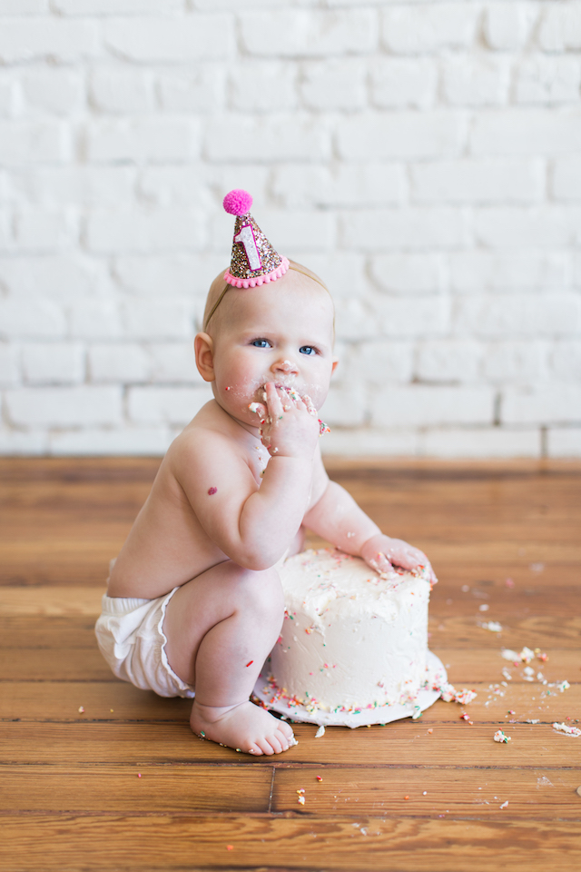 First Birthday Cake Smash, twins first birthday, first birthday party hat, first birthday party, sprinkles birthday party, confetti birthday party, cake smash, sprinkles cake, little blue olive party hat, one eleven east, twin birthday, twin photography, baby photography, modern baby photoshoot, modern baby birthday party, modern birthday party, jesse coulter, hanna andersson, baby style, baby fashion, kids birthday party, boy girl twins