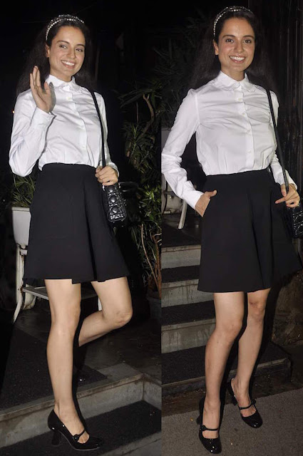 Kangana school girl look with a black skater skirt and a crisp white shirt buttoned up