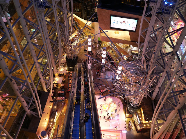 Looking down at a multistory escalator in Langham Place