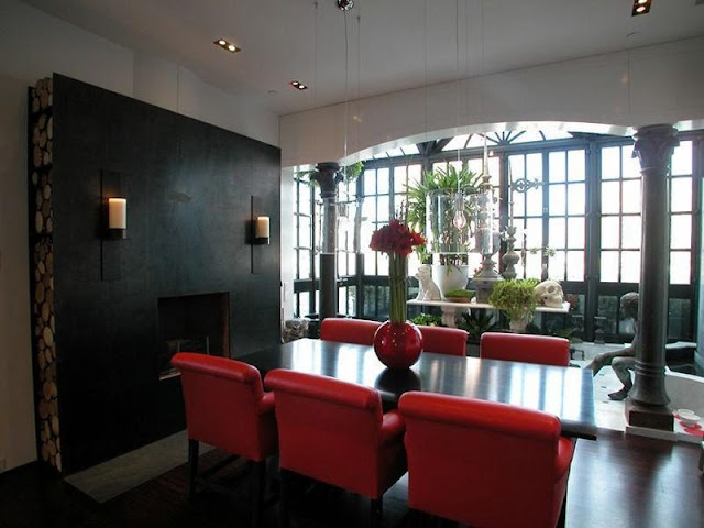 Photo of dining table with red chairs in the dining room