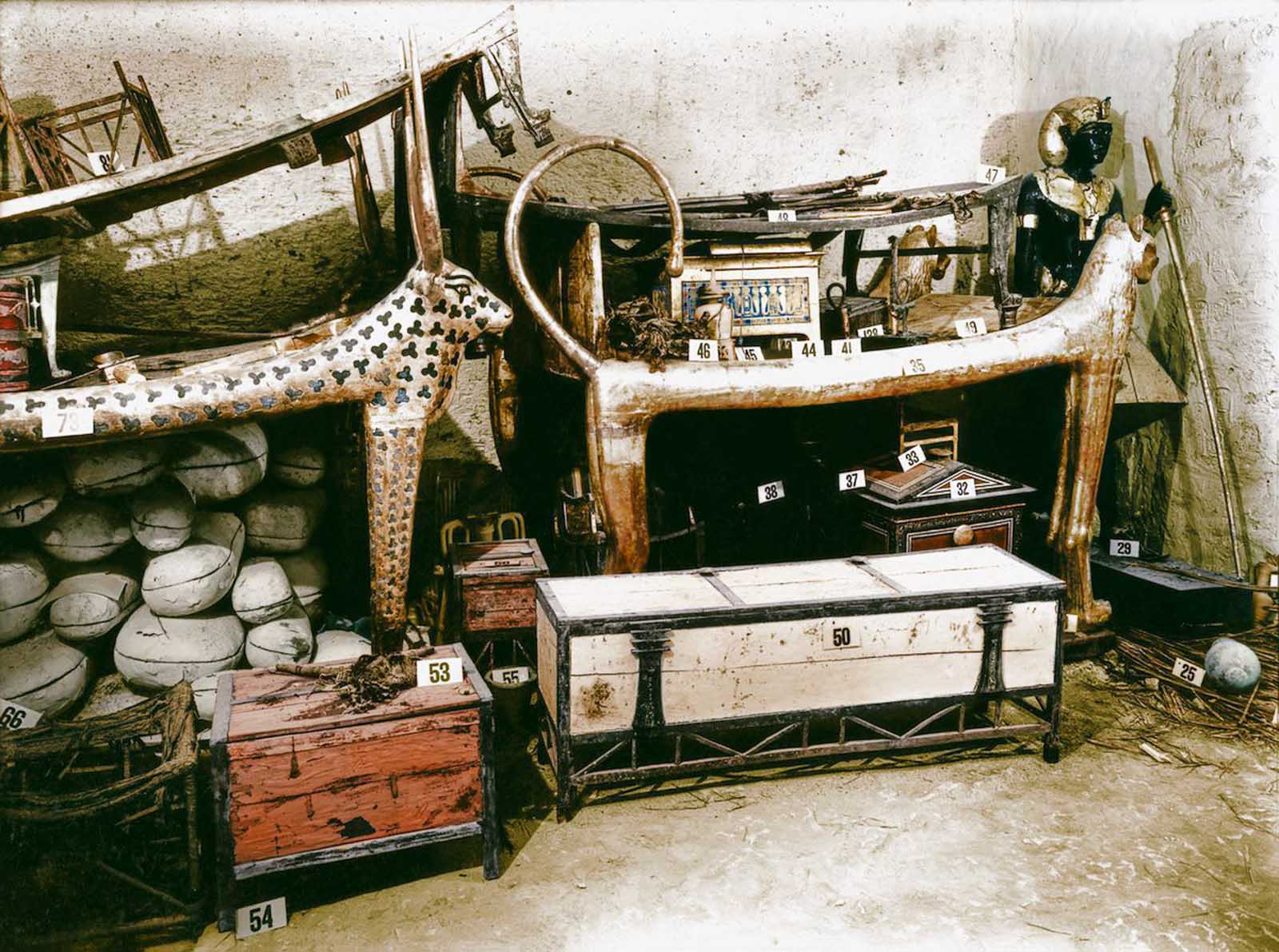 A gilded lion bed and inlaid clothes chest among other objects in the antechamber.