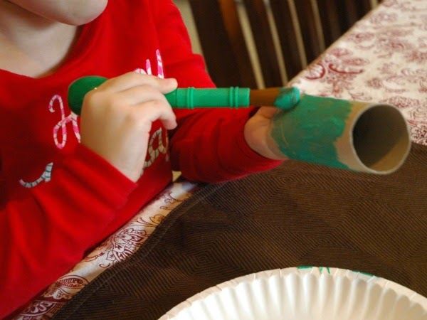 painting tube green for Grinch Craft