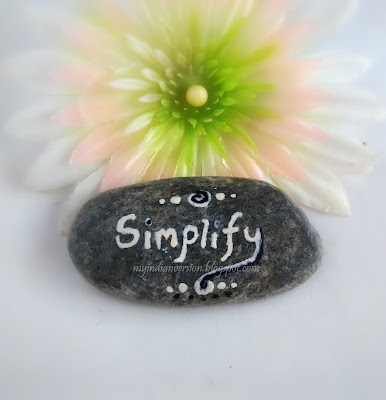 simplify-reminder-on-rock-pebble-in-office-myindianversion
