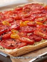https://salzkorn.blogspot.com/2012/07/tarte-mit-confierten-tomaten-auf-pesto.html