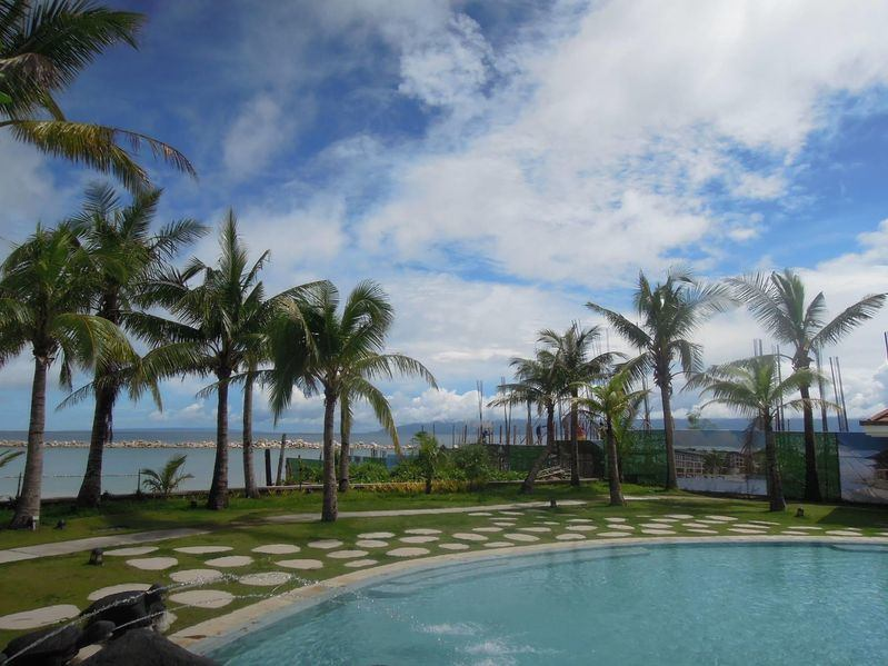 Misibis Bay pool area surrounded by coconut trees
