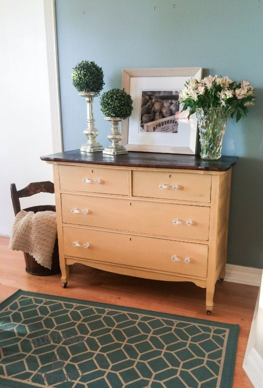 yellow dresser with glass pulls