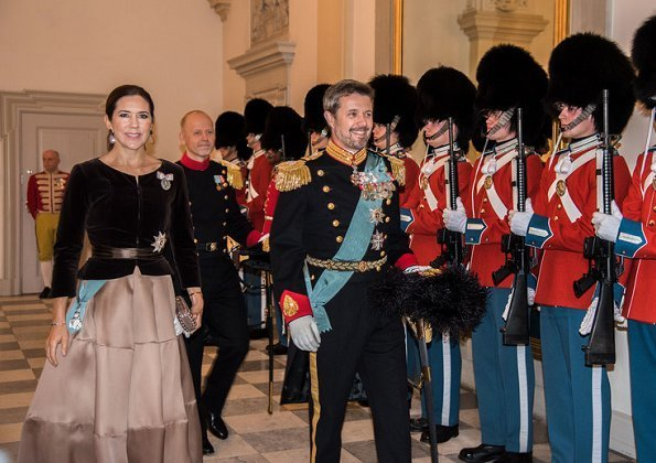 Crown Prince Frederik and Crown Princess Mary attended New Year reception. Princess Mary wore satin skirt