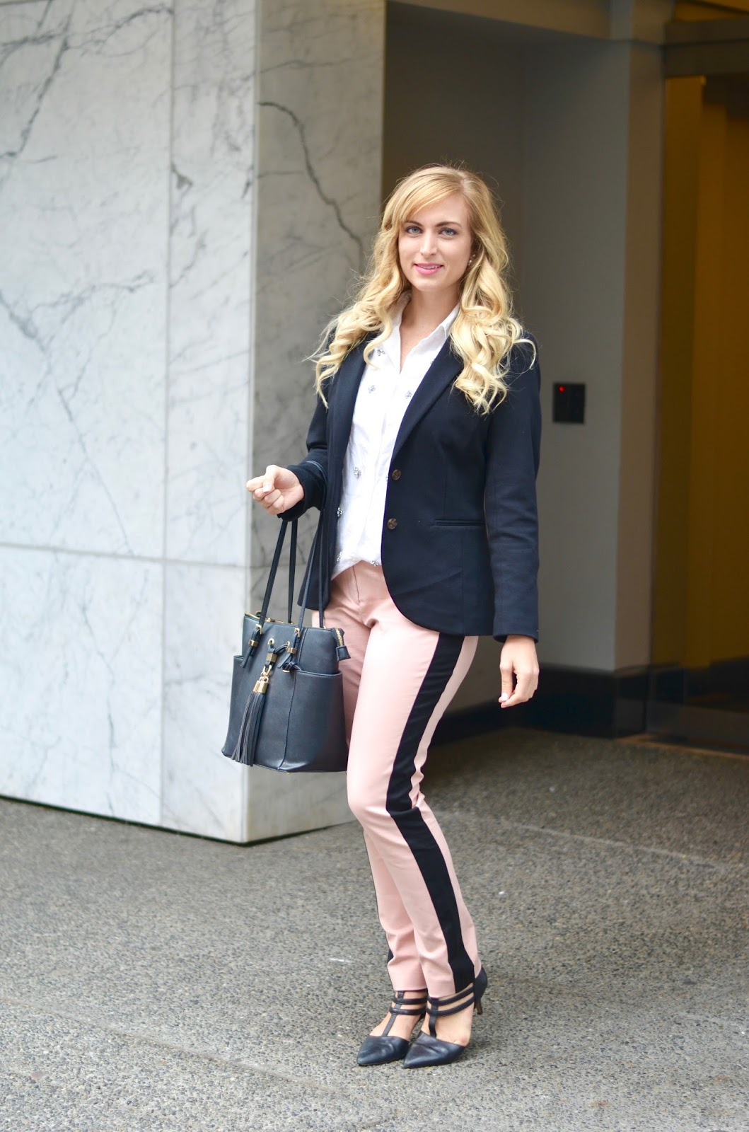pink pants with black racing stripe