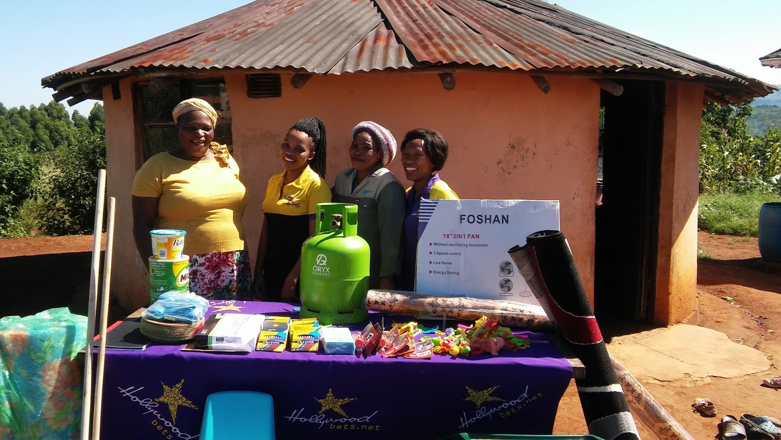 Staff members at the Mthombeni Crèche are happy to receive a donation from Hollywoodbets