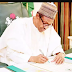 Buhari signs minimum wages bill into law