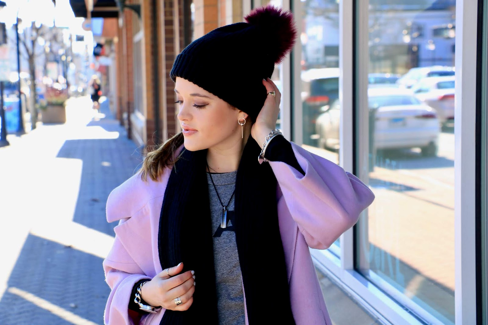 Nyc fashion blogger Kathleen Harper wearing a purple and black pom beanie