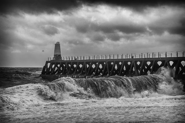 Photo the waves rolling in by Maryport lighthouse