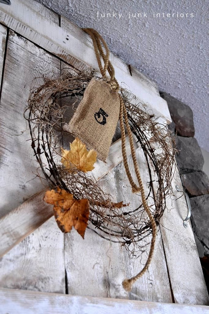 A barbed wire wreath and fall mantel by Funky Junk Interiors