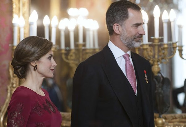 Queen Letizia attends the annual Foreign Ambassadors reception at the Royal Palace. Queen Letizia wore Felipe Varela Long sleeve dress in red