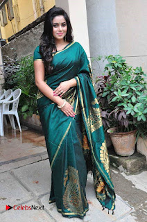 Actress Poorna Latest Pictures in Green Saree at SR Fashion Studio Launch  0012.jpg