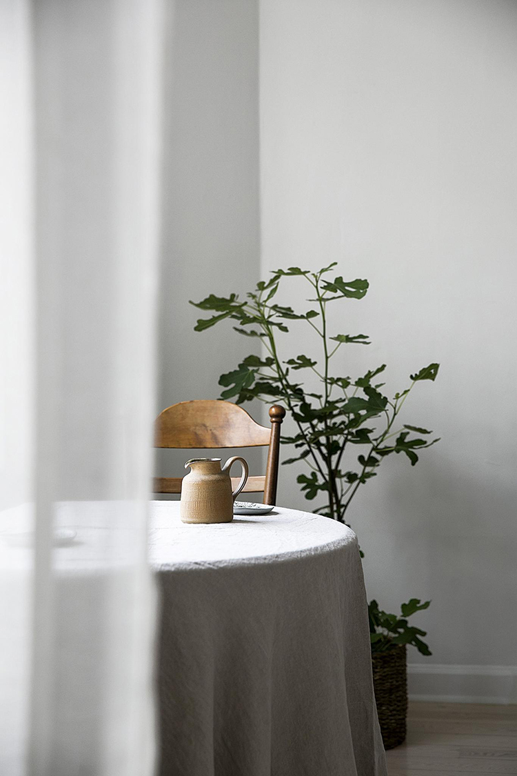 This thing will add an instant cozy vibe to your kitchen. Scandinavian kitchen design and linen tablecloth on the table. Photo via Fantastic Frank