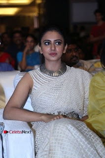 Actress Rakul Preet Singh Stills in White Dress at Winner Pre Release Function  0035.jpg
