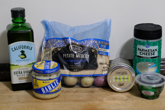 A picture of the ingredients needed to make the roasted garlic Parmesan potatoes.