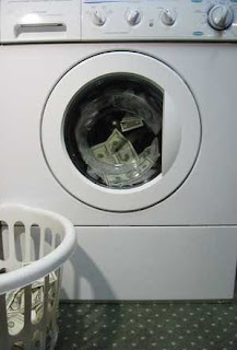Image: money laundering, by Karen Barefoot on freeimages.com