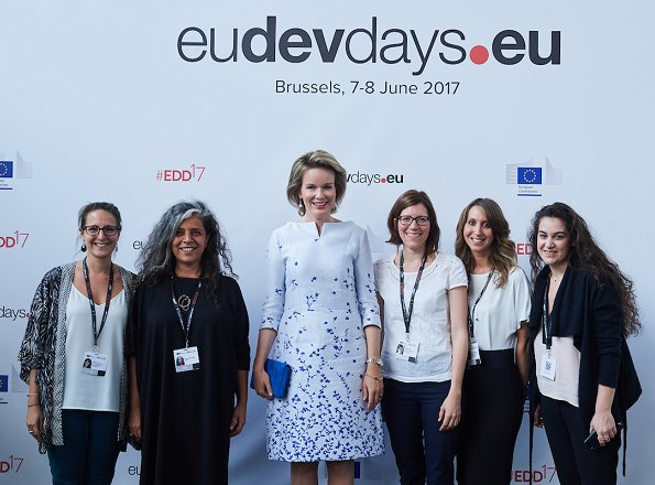 Queen Mathilde attended the opening ceremony of European Development Days at Tour et Taxi and held a lunch at Laken Royal Palace. Queen wore Natan Dress, Clutc and Pumps