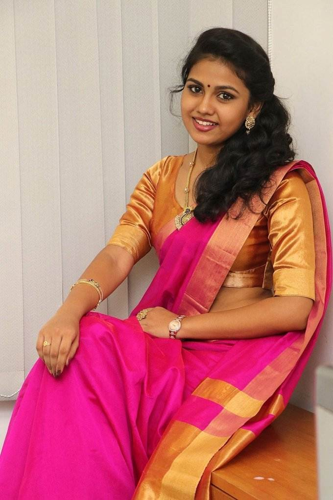 Glamorous Chanai Girl Rahaana Long Hair Photos In Traditional Red Sari