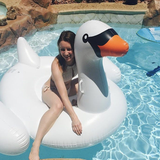 Halter two piece bikini white white crochet on giant inflatable swan