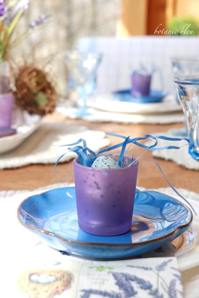 blue-and-purple-placesetting-with-votive-egg-nest