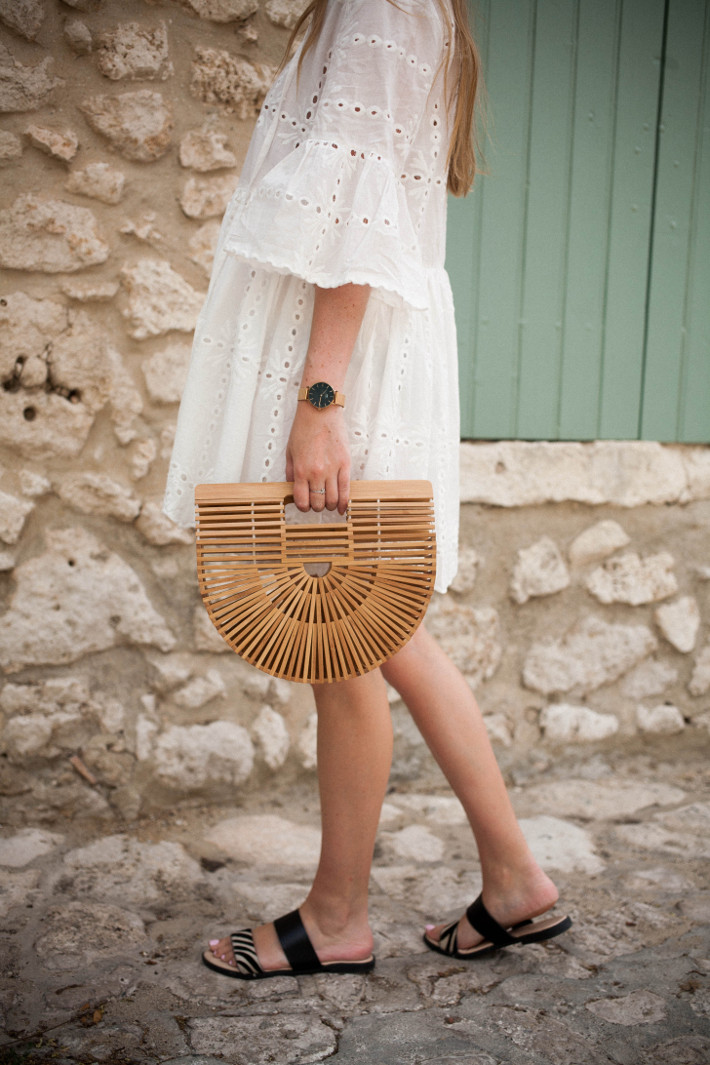 Outfit: white eyelet dress and bamboo bag