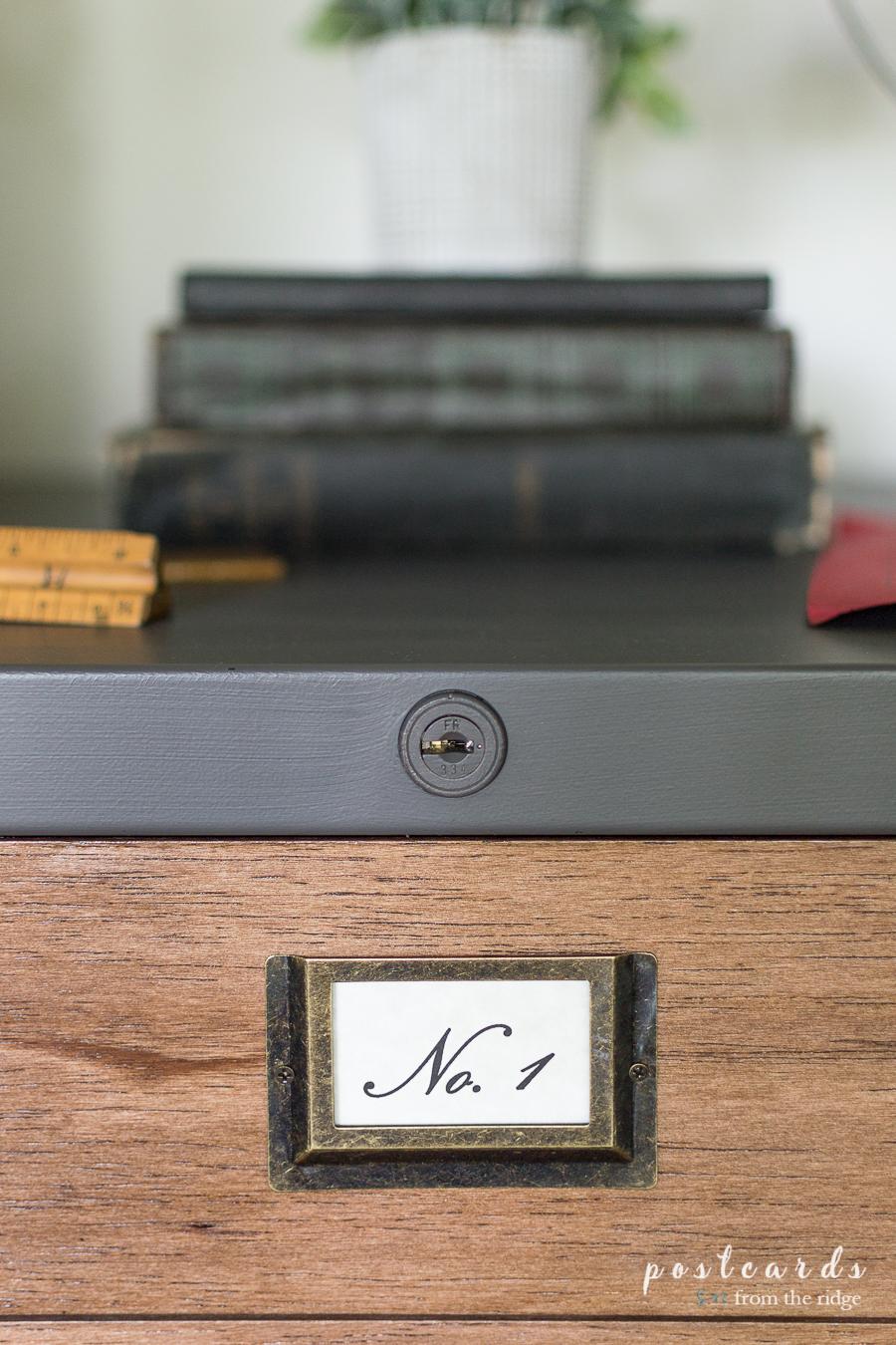vintage labels on file cabinet