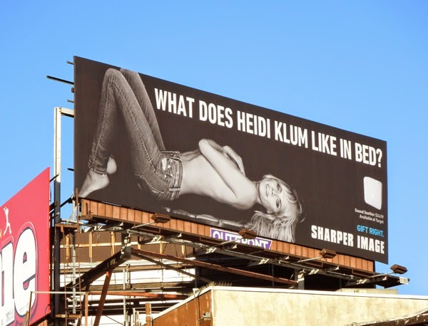 What does Heidi Klum like in bed Sharper Image billboard