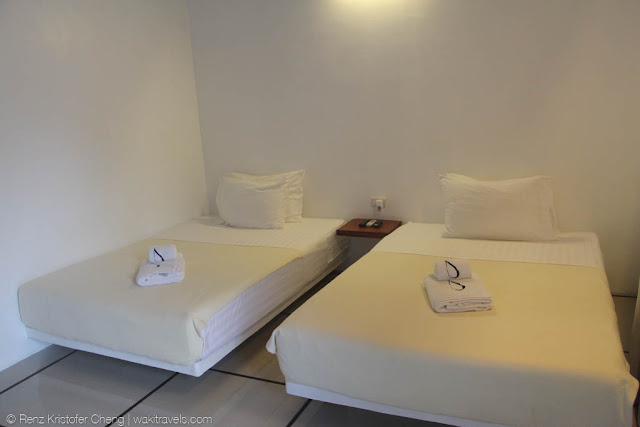 Room and beds of Blue Palawan Resort