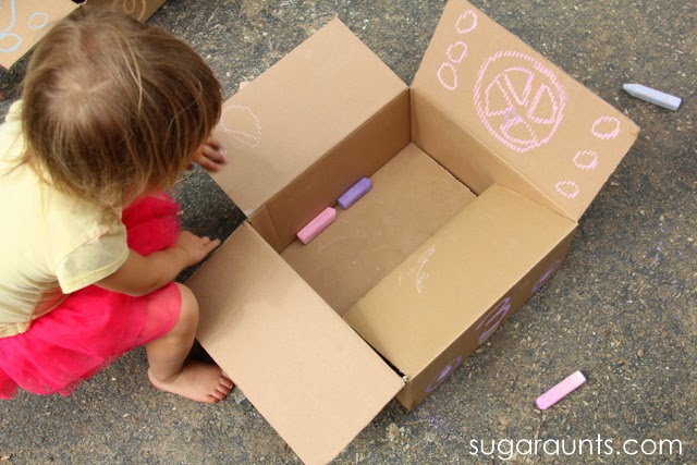 Outside play with a cardboard box.